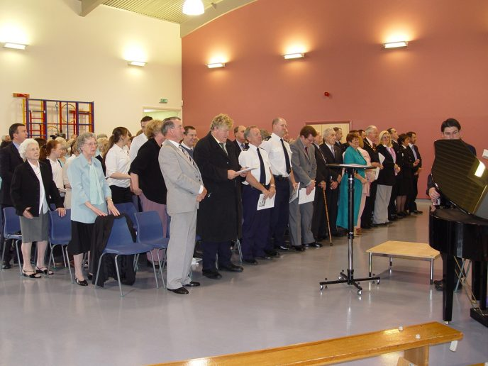 The assembled guests stand in preparation for the official unveiling of the Miners memorial.