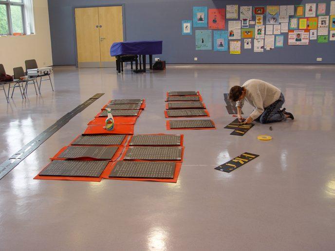 Joanna Daniel prepares the lettering.