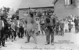 Dancing bear at Massingham school, 1910.