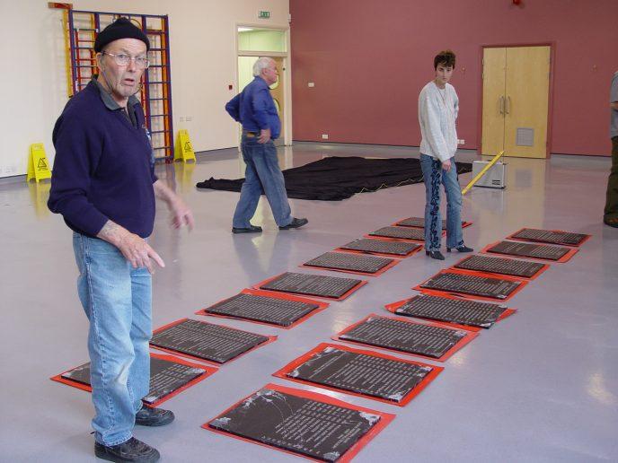 Preparing the plaques. L-R Ken L. James, Trevor John and Joanna Daniel