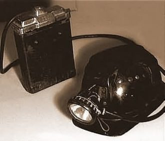 Cap, lamp and battery