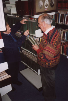 Volunteers working on the library collection