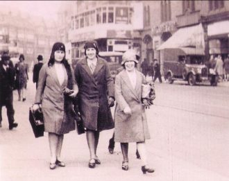 Three Castleford lasses going to work at Sheeny Park tailoring factory in Leeds, 1920