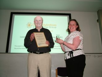 Marden History Group winners of the Community Archive of the Year Award 2011, Laura Cotton Chair of CAHG presenting David McFarland with the award