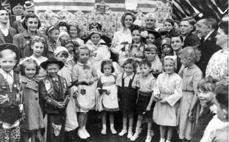 The Coronation Queen on her throne with other children during the coronation celebrations in Aston, 1953