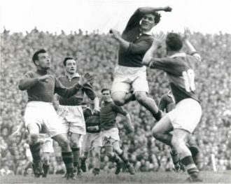 Mayo man Joe Staunton rising to deflect a ball against Kerry in the 1951 Championship