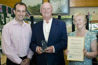 Dr Nick Barratt presenting the Community Archive of the Year Award 2011, in Marden, to David McFarland and Eurice Doswell of the Marden History Group.