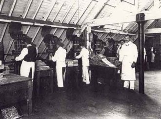 Men working machinery at the Greenbank chocolate factory