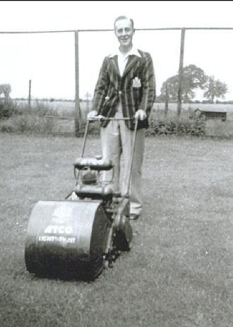 S Smith cutting the grass of the old cricket pitch, 1933