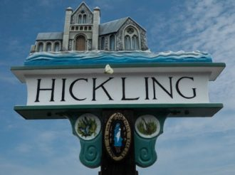 Hickling village sign, showing church and the name Hickling | Photo by Martin Johns